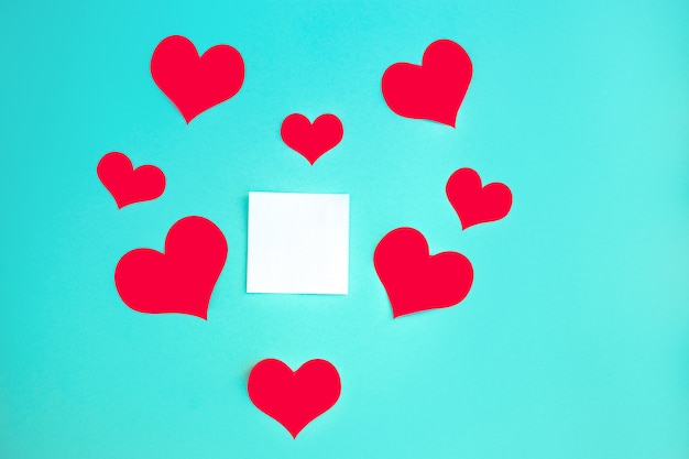 Valentine's day background. red hearts on pastel blue background. valentines day concept. flat lay, top view, copy space