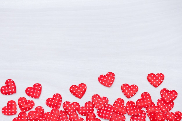 Valentine's day background. red hearts on white wooden background. valentines day, love, wedding concept. flat lay, top view.