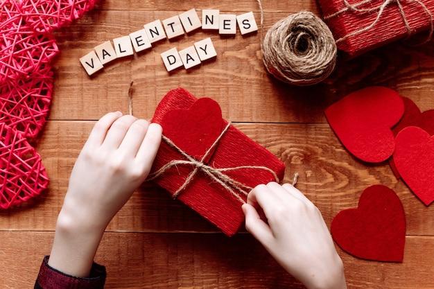 Valentine's day background. valentine gift making, diy hobby. children's diy concept. making heart decoration or greeting card. handmade concept.