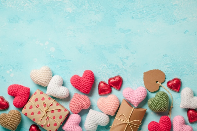 Valentine's day background with colorful hearts and gift boxes