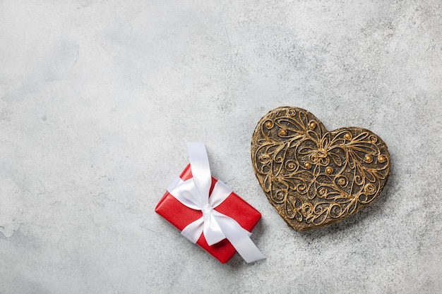 Valentine's day background with decorative heart and gift box