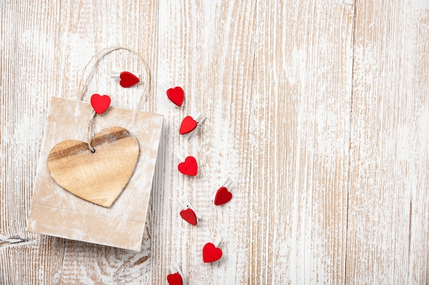 Valentine's day background with gift bag and heart decoration