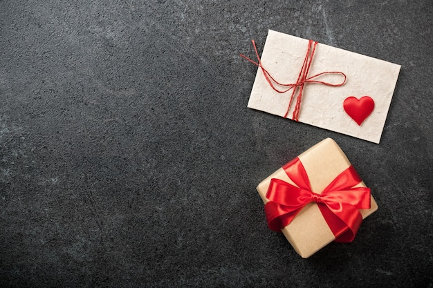 Valentine's day background with gift box and envelope
