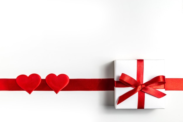 Valentine's day background. . with gift and red hearts, top view. san valentine and the concept of love.