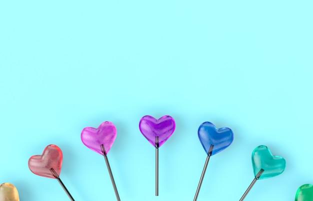 심장 롤리팝 캔디와 함께 발렌타인 배경입니다.