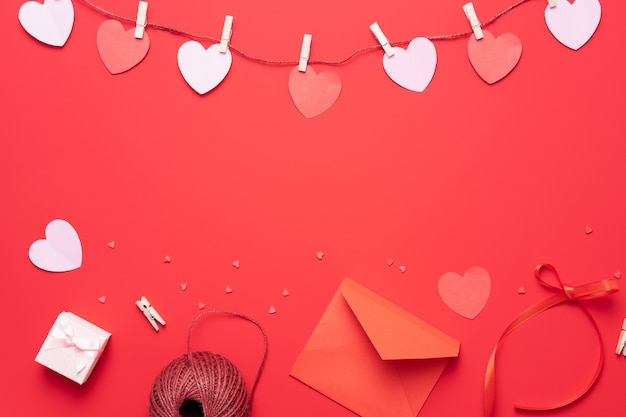 Valentine's day background with heart shape decorations, gift and ribbons. view from above.