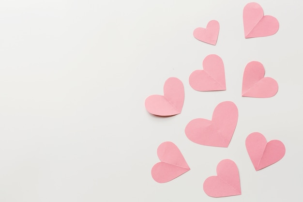 Valentine's day background with hearths on white