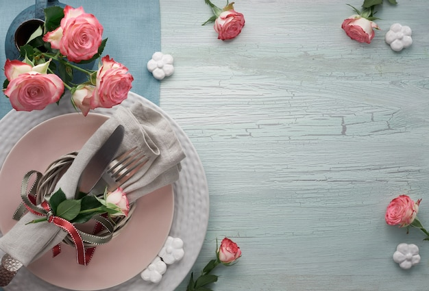 Valentine's day, birthday or anniversary table setup, top view on light rustic table, copy space