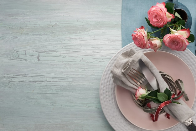 Valentine's day, birthday or anniversary table setup, top view on light rustic table,