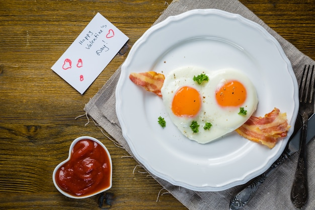 Valentine's day breakfast - eggs, bacon, ketchup