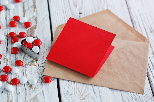 Valentine's day card with small hearts and red white candy