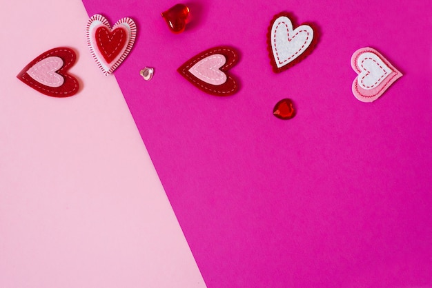 Valentine's day card with space copying. a variety of hearts on pink and purple background