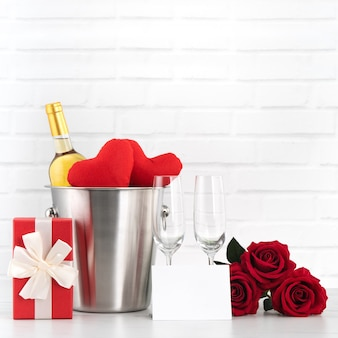 Valentine's day celebration with wine, gift and rose bouquet for holiday greeting.