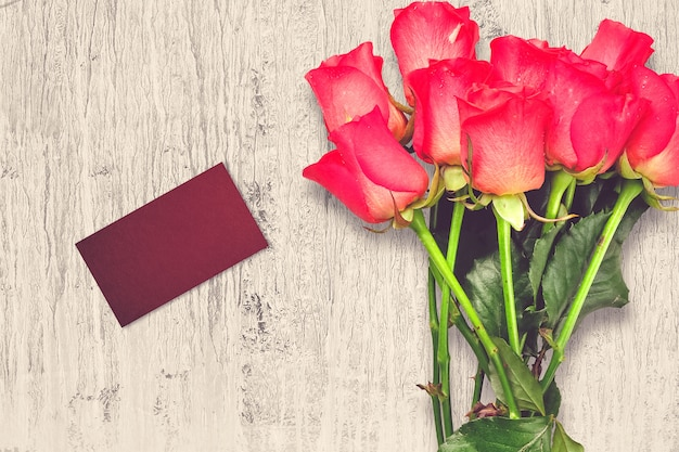 Valentine's day composition with rose flowers and greeting card