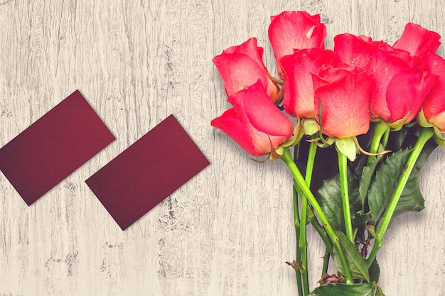 Valentine's day composition with rose flowers and greeting cards
