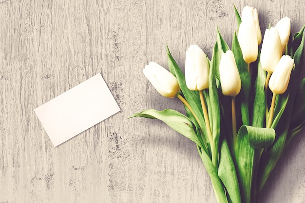 Valentine's day composition with tulip flowers and greeting card