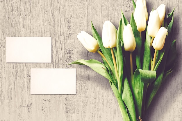 Valentine's day composition with tulip flowers and greeting cards