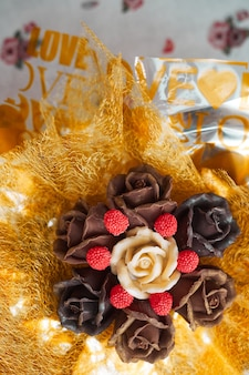Valentine's day concept, chocolate bouquet of roses in gold packaging, copy space