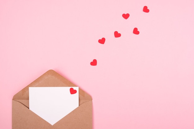 Valentine's day concept. envelope with a love letter on a pink background.