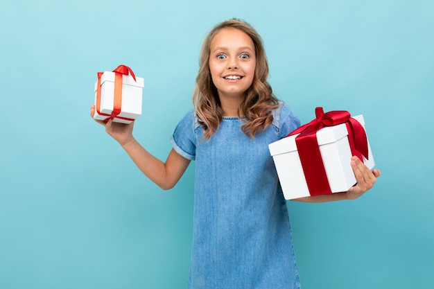 Valentine's day concept. girl with two boxes of gifts on light blue