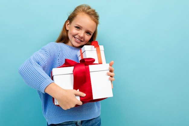 Valentine's day concept. smiling girl with gifts with copy space
