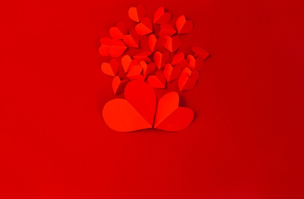 Valentine's day concept with red hearts on red background,  flat lay, copy space