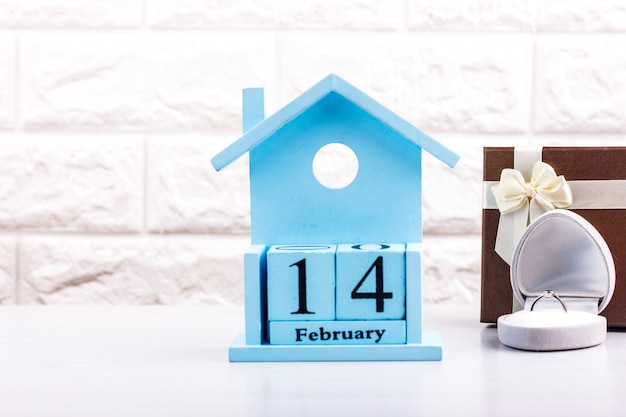 Valentine's day on the cubes of the calendar with gift box and diamond ring