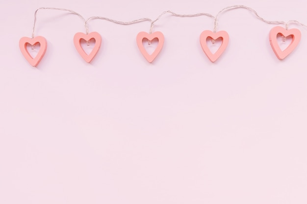 Valentine's day decoration - heart shaped lights on a pink background