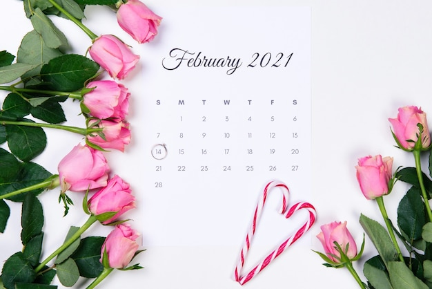 Valentine's day february calendar, diamond ring, red heart and pink roses on white backround.