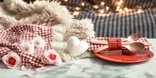 Valentine's day festive dinner on a wooden table cutlery