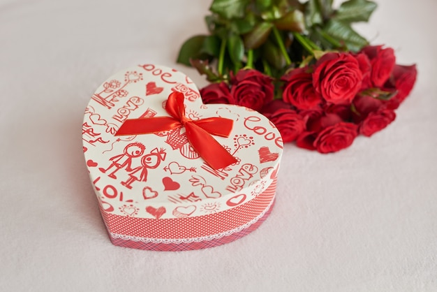 Valentine's day gift box and red roses