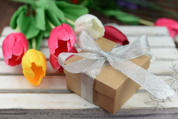 Valentine's day gift box with bow with tulips flowers