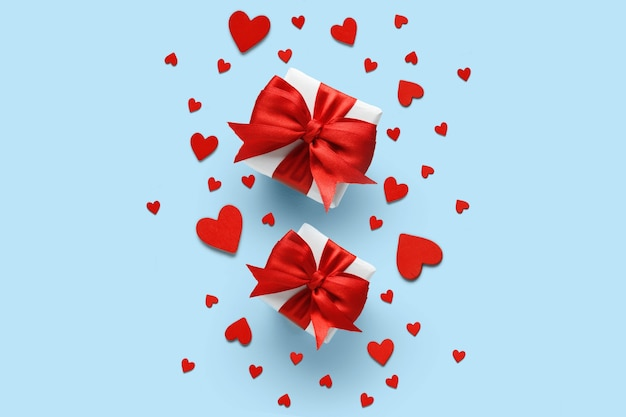 Valentine's day gifts with red bows and hearts