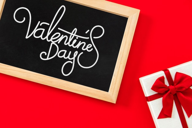 Valentine's day greeting text in blackboard with gift box