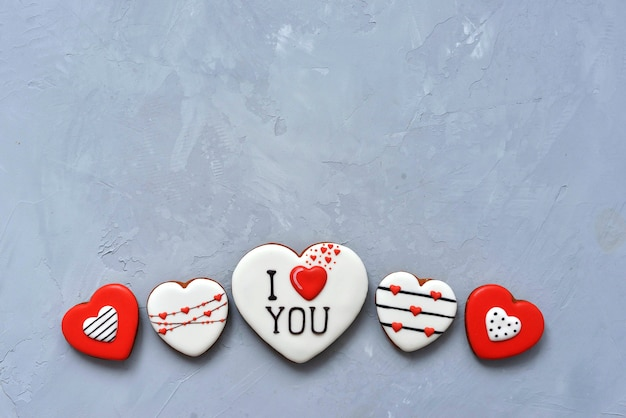 Valentine's day homemade cookies on ultimate gray background covered with icing with a beautiful pattern gingerbread.