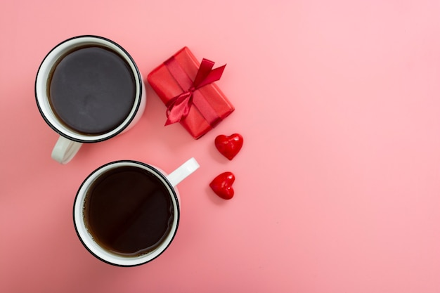 Valentine's day pink breakfast. flat lay view of two cups and red gift boxes.