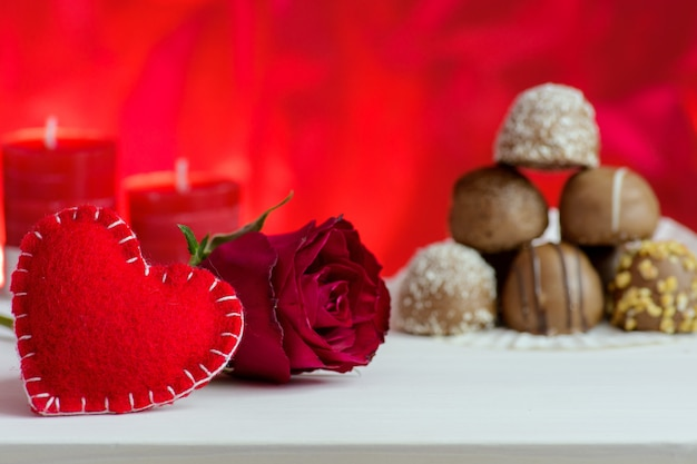 Valentine's day red background with roses and chocolate.