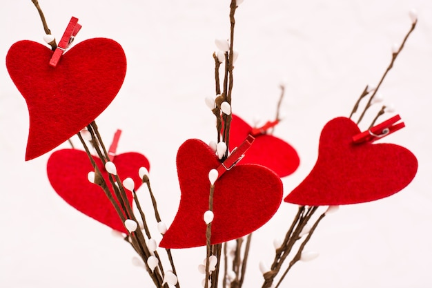 Valentine's day. red felt hearts on willow branches   .