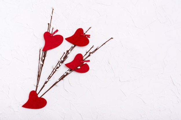 Valentine's day. red hearts made of felt on willow branches  . copy space