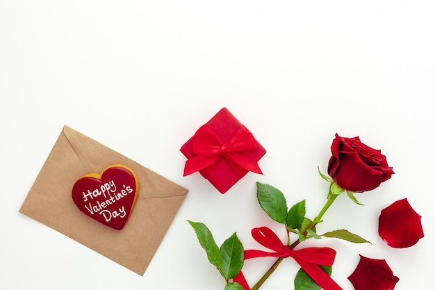 Valentine's day. red rose with a ribbon, love letter and red box.