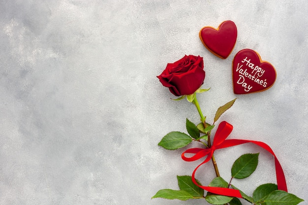 Valentine's day. red rose with a ribbon,