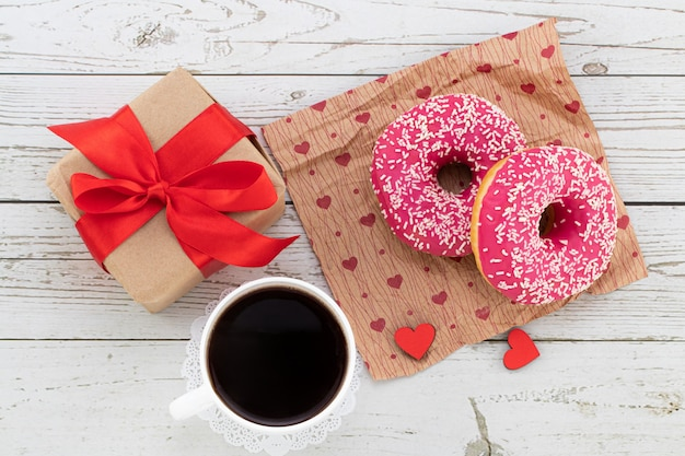Valentine's day romantic breakfast. gift, hearts and donuts. valentines day concept. copy space