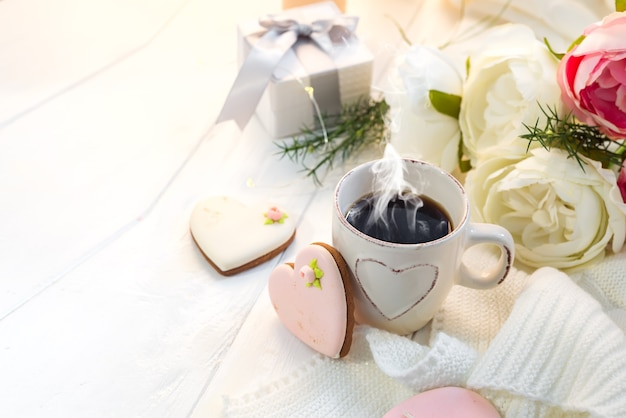 Valentine's day romantic breakfast with gingerbread heart with icing and cup of coffee