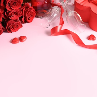 Valentine's day romantic set, red roses, gift, hearts chocolate sweets on pink. greeting card with copy space.