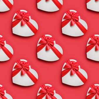 赤の白いハートボックスのバレンタインデーのシームレスなパターン