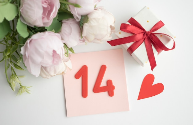 Valentine's day, simple desk calendar and roses.