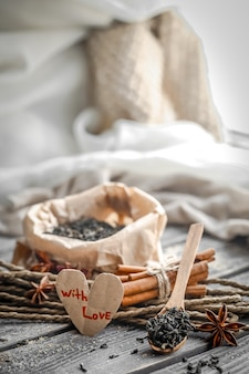 Valentine's day still life with tea and a heart on wooden background