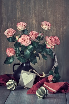 Valentine's day still lifewith wooden calendar, pink roses, heart and dry limes
