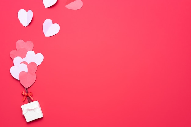 Valentine's day with red and pink hearts and box
