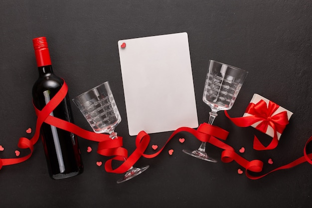 Valentine's day with wine and gift, blank sheet for text